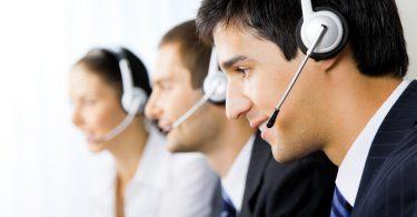Three support phone operators at workplace-techblogcorner